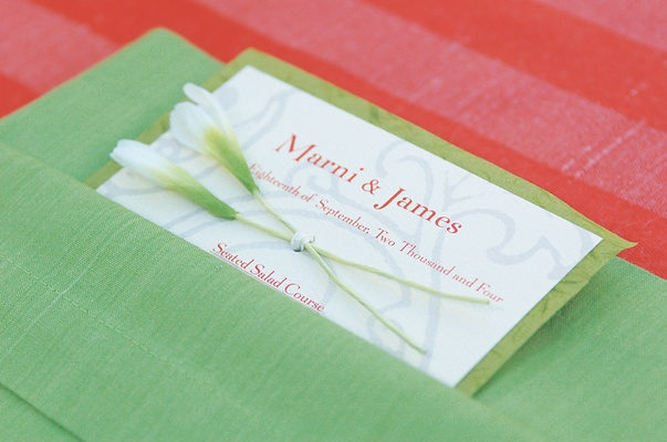 Wedding menu on white stationery in orange print with green background