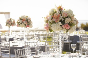 Crystal centerpiece designs with white hydrangea, orange lily, pink rose flowers and hanging crystal