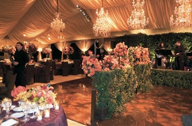 Tent wedding with hedges on dance floor
