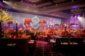 Purple lighting and colorful table centerpieces