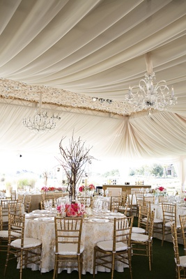 Tented wedding reception with golden chiavari chairs