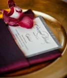 Brock Osweiler and Erin Costales wedding menu in burgundy napkin