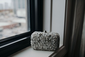 Suzanna Villarreal and Alex Wood LA Dodgers wedding bride bag clutch silver white detail jewels