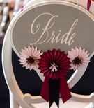 Bride sign on back of chair with horse show ribbons