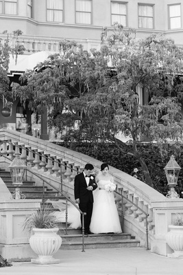 bride and father walk down staircase at langham hunting pasadena hotel
