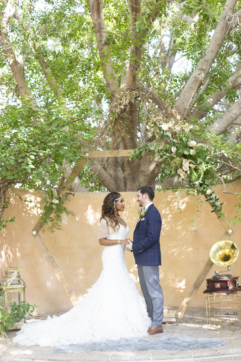 great gatsby inspired garden wedding styled shoot with octagon frame altar, interracial couple 1920s