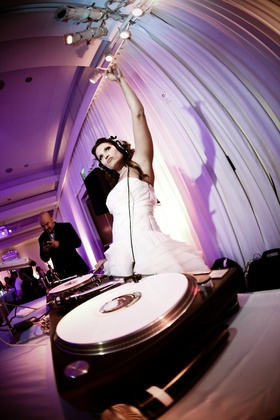Bride wearing headphones at DJ spin scratch station