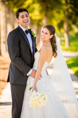 bride in strapless monique lhuillier wedding dress lace appliques ivory bouquet veil half up down