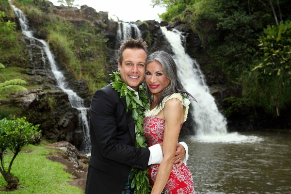 Angus Mitchell, co-owner of John Mitchell Systems, and his mother at his hawaiian wedding