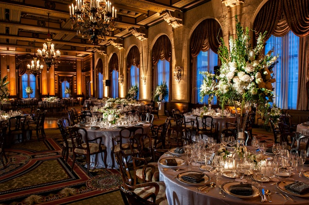 lavish ballroom with chandeliers and ornate windows