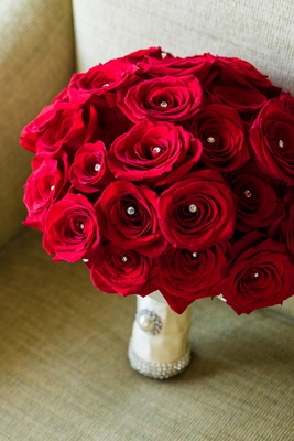 bridal bouquet of red roses with crystals in the middle
