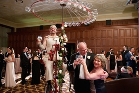 Wedding cocktail hour with bicycle riding wine server, The Standard Club, Chicago