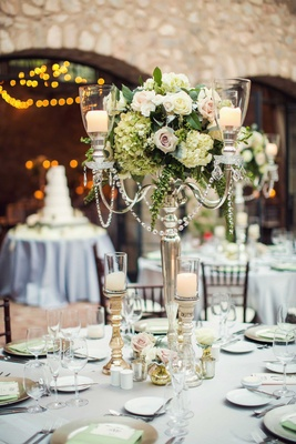 Wedding reception at Tuscan inspired venue silver candleabra hydrangea roses gold candleholders