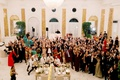 mariana paola vicente and kike hernandez wedding guests in white ballroom wedding cake celebrating
