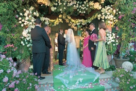 Jewish wedding ceremony under flower chuppah