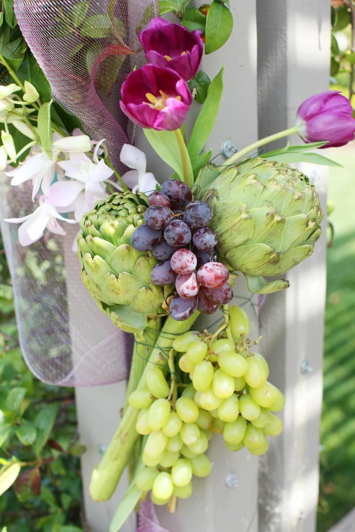 Wedding ceremony structure flower and fruit arrangement
