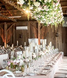 rustic-chic barn wedding reception, floral installation over tables