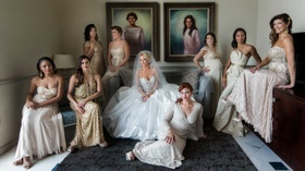 Bride in a strapless Ines Di Santo wedding dress with beaded bodice & bridesmaids in golden dresses