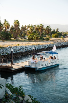 boat bringing guests to ceremony location at destination wedding in cabo san lucas
