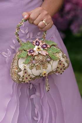 Mother of the bride holding jewel flower purse