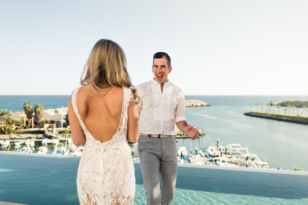 """first look"" reveal in destination wedding in cabo, bride with backless lace dress"