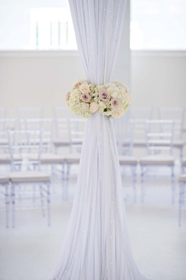 Wedding canopy fabric tied with romantic floral belt