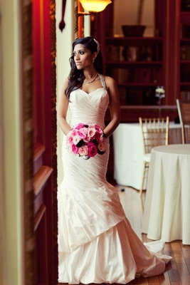Ines Di Santo wedding dress on bride with pink bouquet