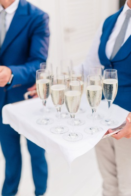 glasses of prosecco on silver tray draped with white fabric