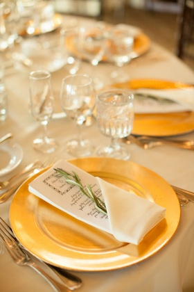 gold plates for wedding, menu with sprig of greenery