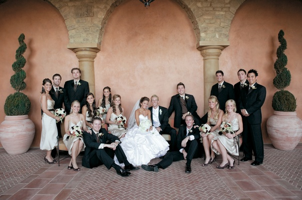 Bride and groom with bridesmaids and groomsmen at country club