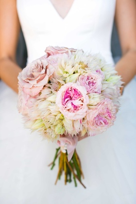 a soft bouquet featuring blush, ivory, and off-white flowers