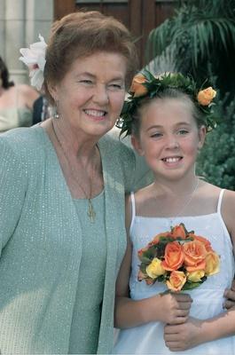 flower girl wearing orange rose wreath