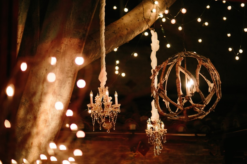 Chandeliers and lantern made of branches at reception
