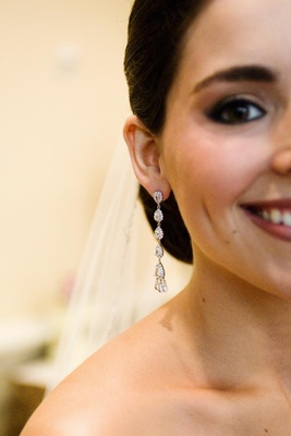 Diamond drop earrings on bride