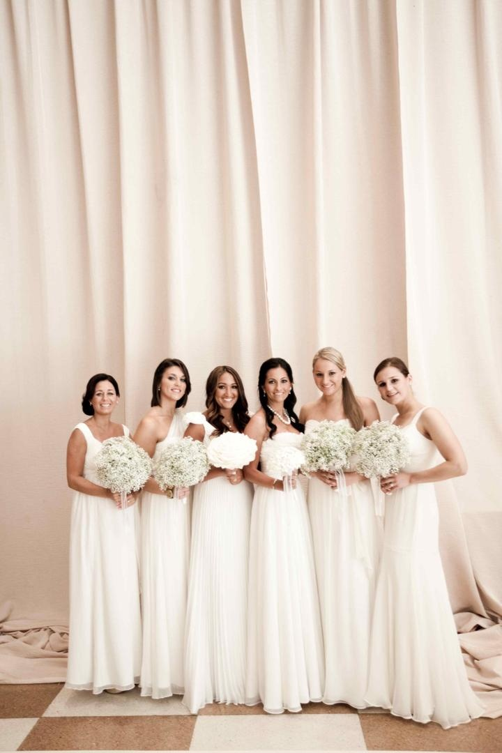 Mismatched floor length bridesmaid dresses in white