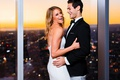 bride in strapless lazaro corset dress, groom in black jacket and grey pants, dtla sunset