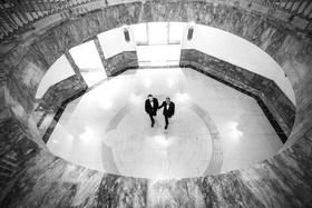 black and white photo of grooms in tuxedos at harold washington library gay lgbt wedding ideas