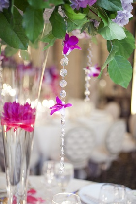 Wedding reception centerpiece with greenery, floating magenta peony, crystal beads and hot pink orc