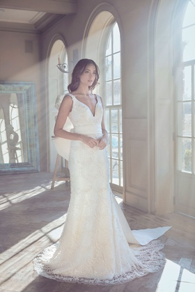 Sareh Nouri Spring 2019 collection lace gown with cummerbund bow and chapel train