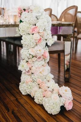 Wedding reception wood floor mirror table with white hydrangea blush rose flower runner on floor