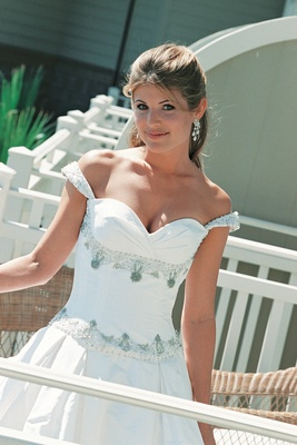 wedding dress with off the shoulder neckline and beading