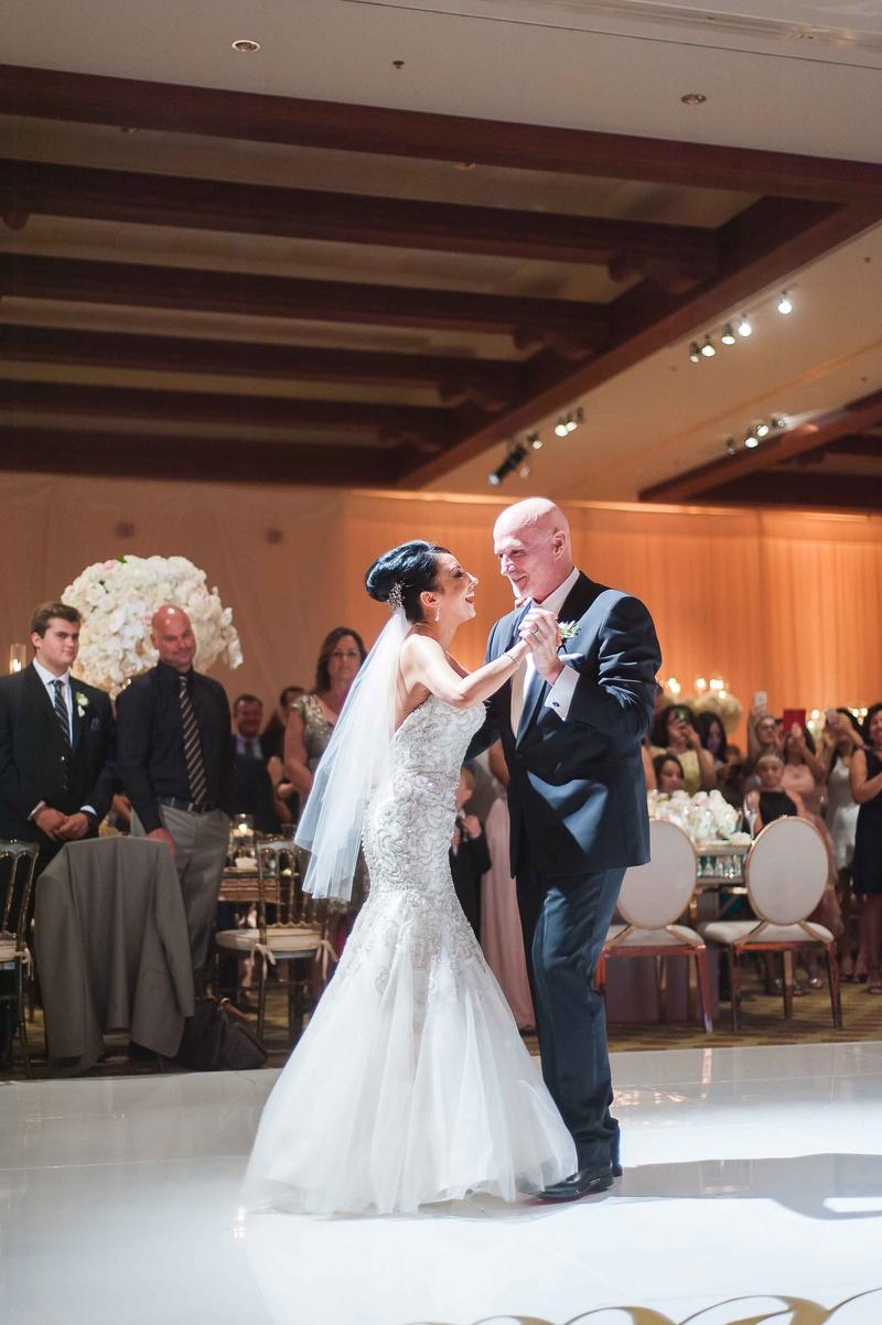 Bride and groom vow renewal anniversary party mermaid trumpet gown veil updo dancing dance floor