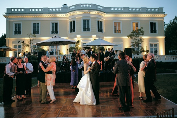 Outdoor dance floor in front of large California mansion