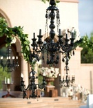 Outdoor wedding ceremony with black chandeliers decorations