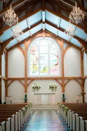 chapel ceremony venue stain glass windows west virginia greenbrier hotel resort pews wedding