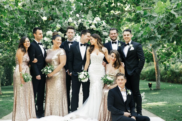 Jillian Murray in Berta wedding dress dean geyer with bridesmaids in gold sequin dresses groomsmen