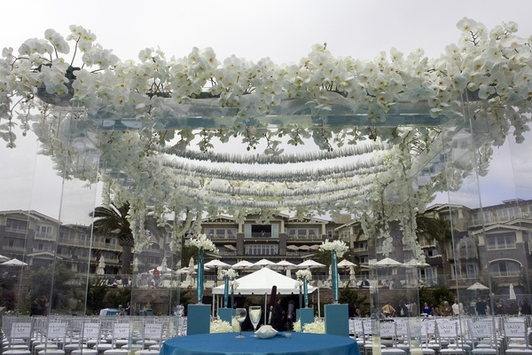 lucite chuppah topped with white orchids and paper cranes