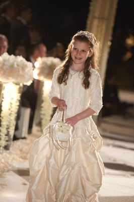 Flower girl walking down aisle with basket
