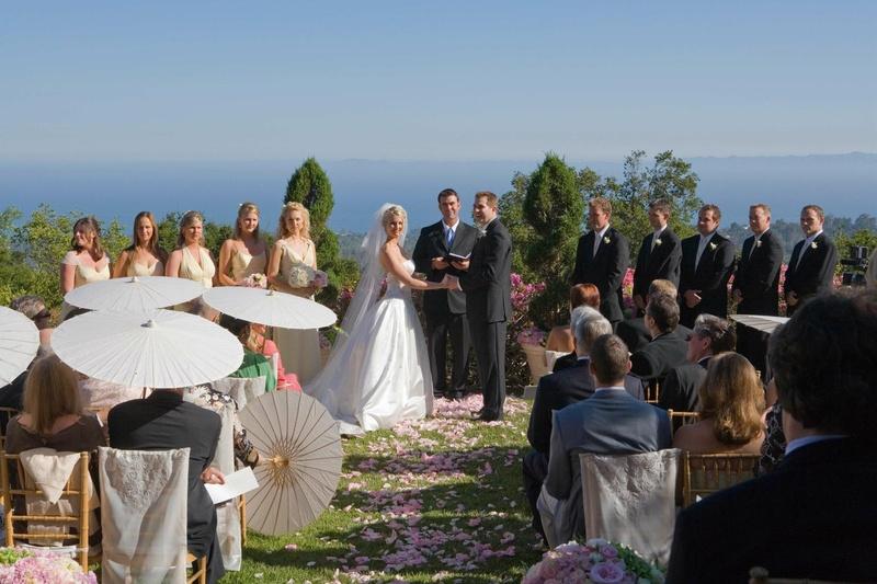 Bridesmaids and groomsmen at altar