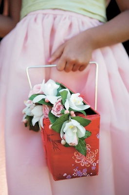 oversized takeout box filled with flowers for flower girl